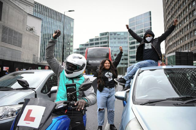 Demonstrators block traffic outside Victoria Station