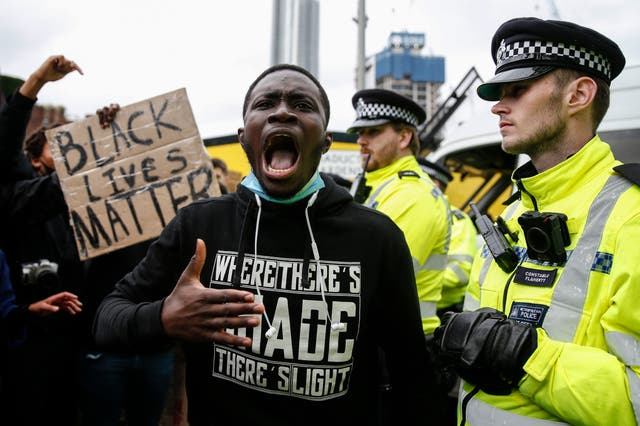 Protesters demonstrate near the the US Embassy in Nine Elms in London