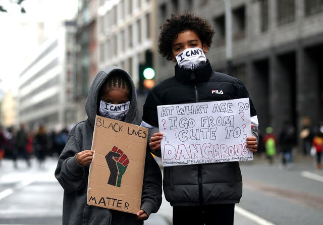Children pose for a photo during a Black Lives Matter protest at Parliament Square