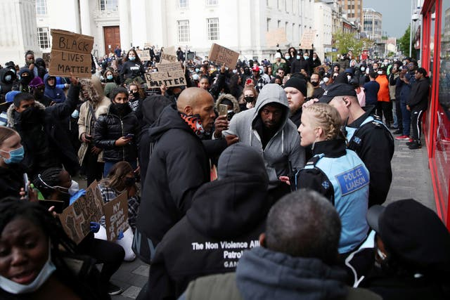 Demonstrators are seen wth police liaison officers during a Black Lives Matter protest in Luton