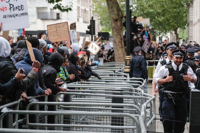 Demonstrators gather outside Downing Street