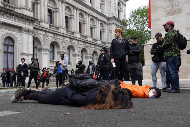 Demonstrators lay on the pavement during a Black Lives Matter rally at Trafalgar Square