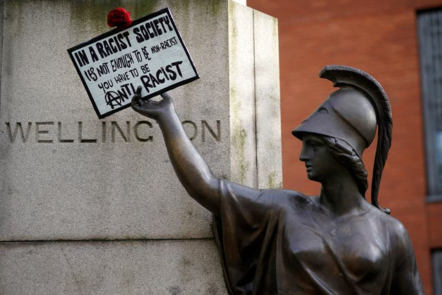 A protest placard is affixed to the plinth of a statue of the Duke of Wellington on the second day of Black Lives Matter demonstrations in Piccadilly Gardens