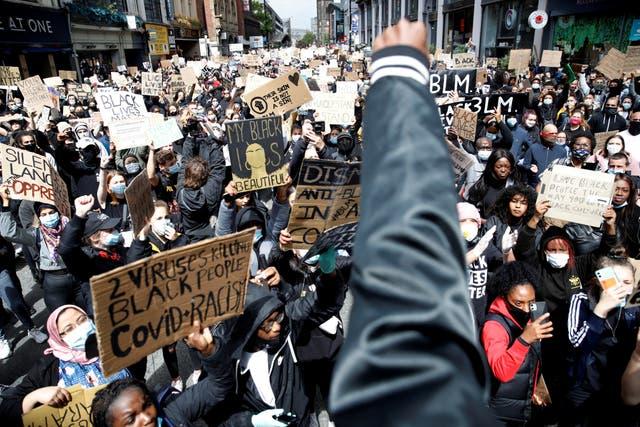 A demonstrator gestures during a Black Lives Matter protest in Manchester
