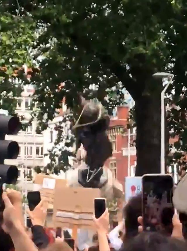 Protesters pulling down a statue of slave trader Edward Colston