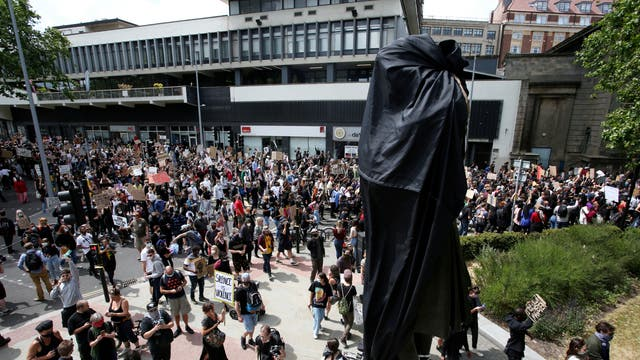 The Edward Colston statue has been pulled down by Black Lives Matter protesters in Bristol. Colston was a 17th century slave trader who has numerous landmarks named after him in Bristol.  Pictured is the statue covered up before it was pulled down