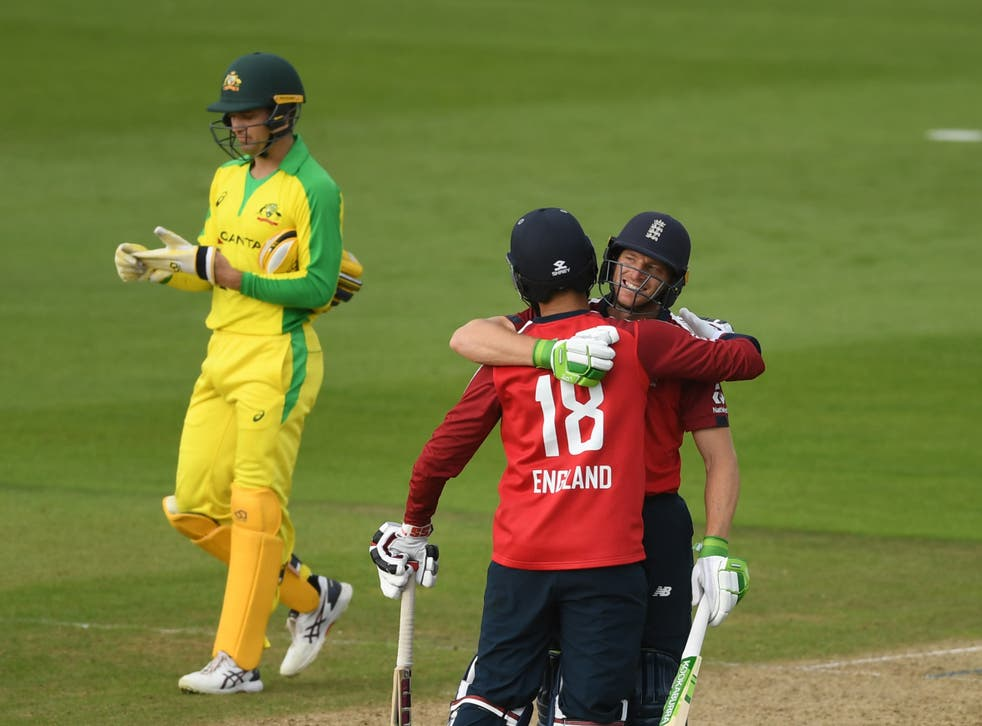 Jos Buttler (right) celebrates with team-mate Moeen Ali