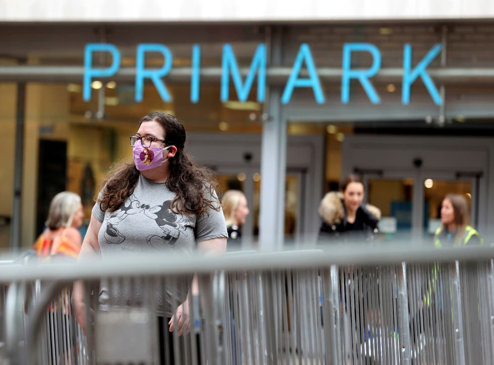 People queue outside a Primark store, after the branch's reopening amid the coronavirus disease