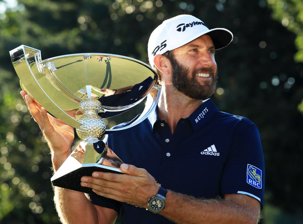 Dustin Johnson with the FedEx Cup trophy