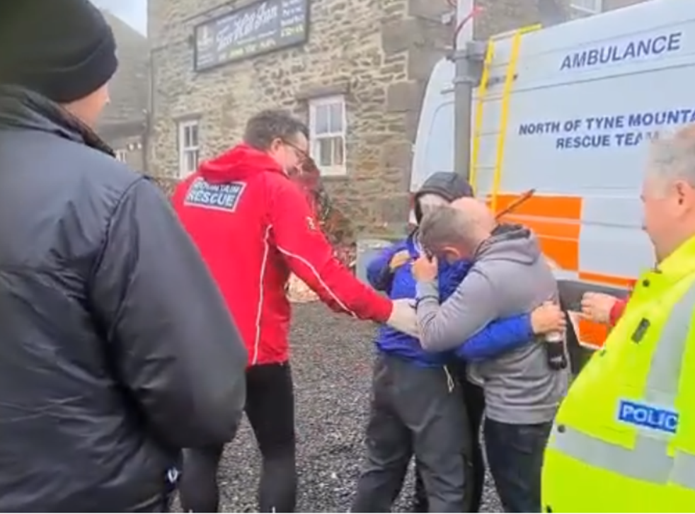 Harry Harvey is embraced by his family after he was reunited with them following four days missing in the Yorkshire Dales