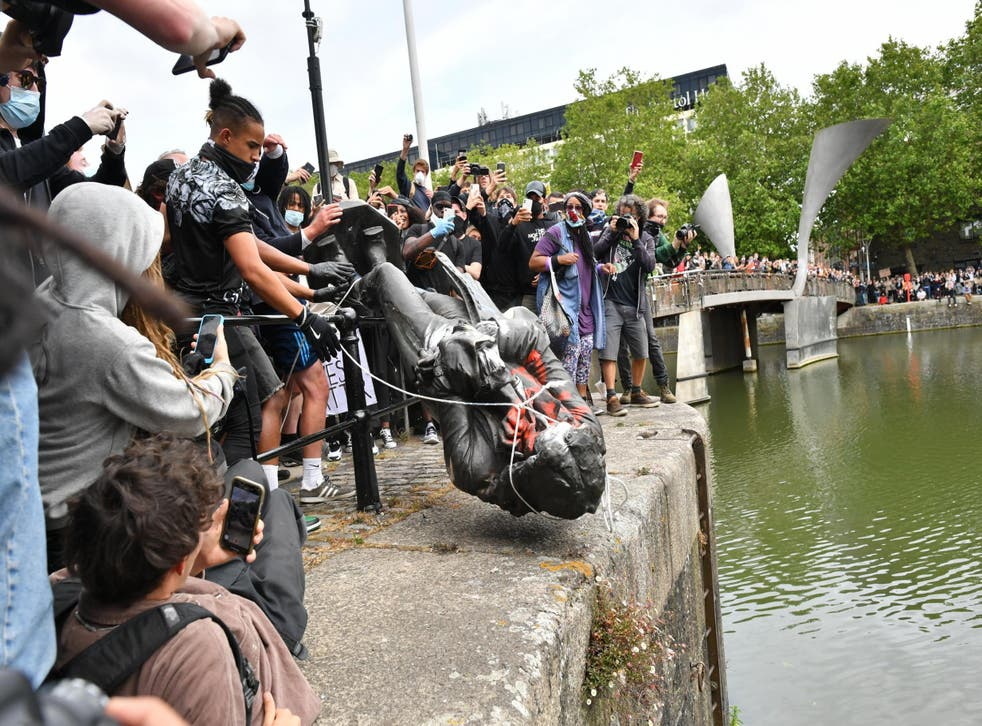 Black Lives Matter protesters throwing the controversial statue of slave trader Edward Colston into Bristol harbour in June