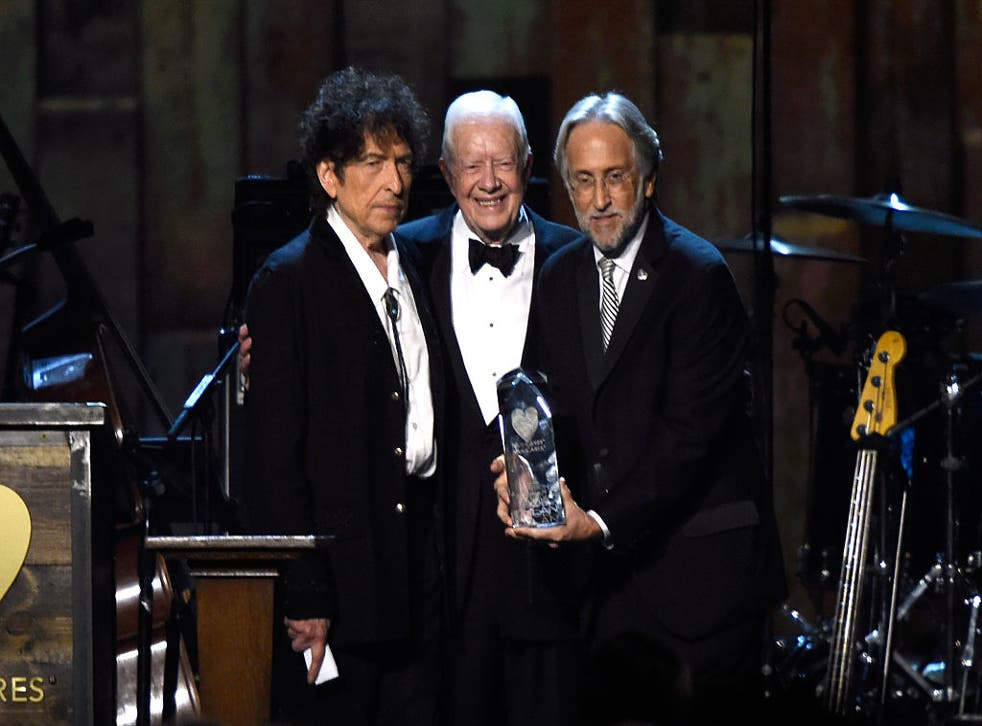 Bob Dylan, former US President Jimmy Carter and National Academy of Recording Arts and Sciences President Neil Portnow appear onstage at the 25th anniversary MusiCares 2015 Person Of The Year Gala on 6 February 2015 in Los Angeles, California