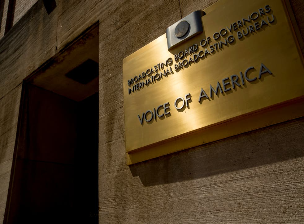 Dozens of Voice of America journalists are protesting Michael Pack's staff purge, threats to visas and accusations that the news outlets he oversees are ripe for espionage.