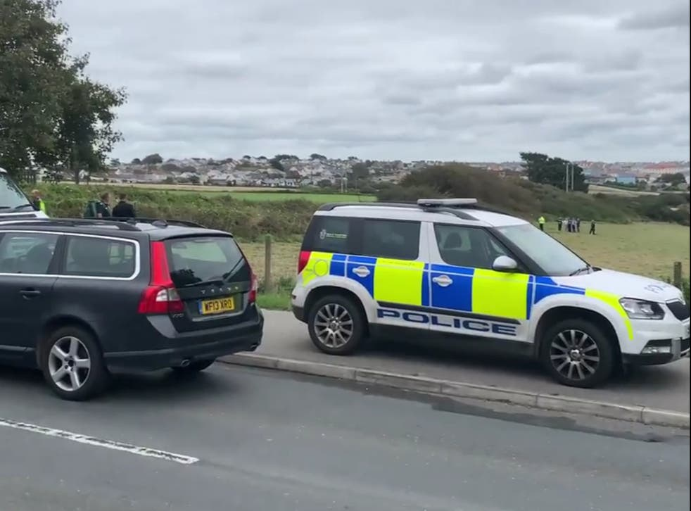 The police officer was attacked while helping bailiffs with an eviction from private land in Newquay, Cornwall
