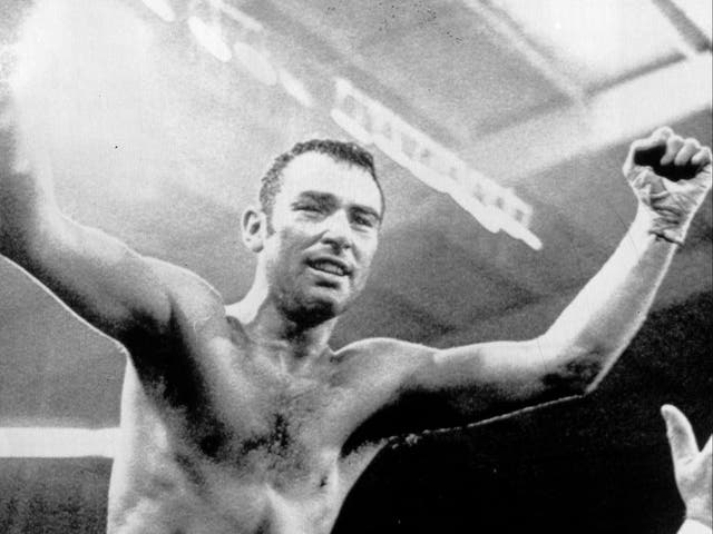 Alan Minter celebrates winning the world title after victory over Vito Antuofermo