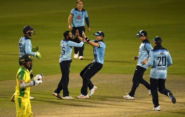 Adil Rashid celebrates taking the wicket of Australia's Alex Carey