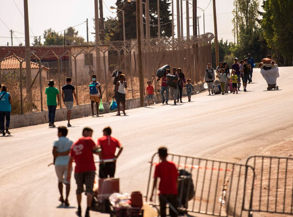 Migrants enter a new temporary camp near Panagiouda, hosting refugees and migrants from the Moria camp destroyed by a fire on the night of September 8th