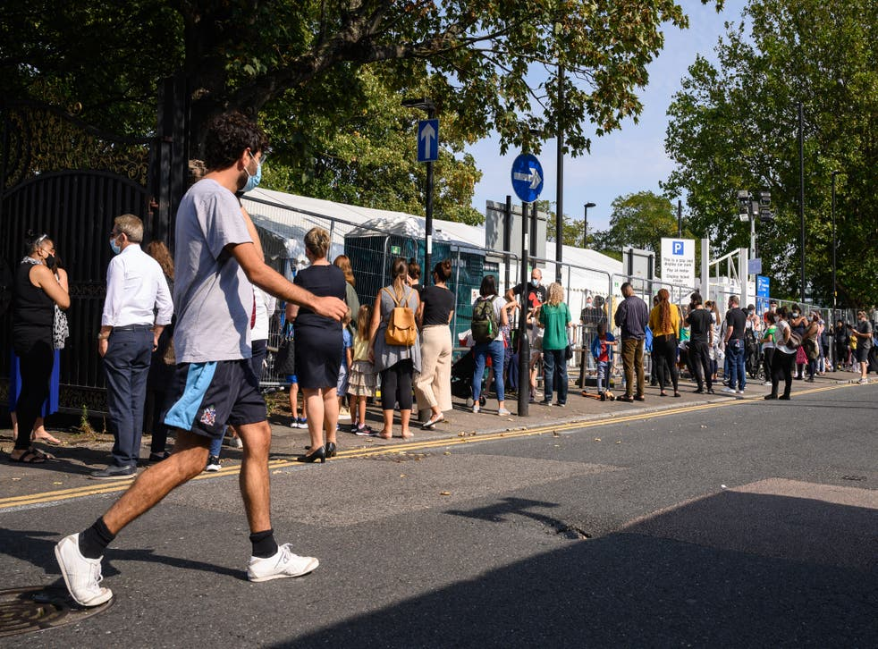 People queue up for a coronavirus test in London