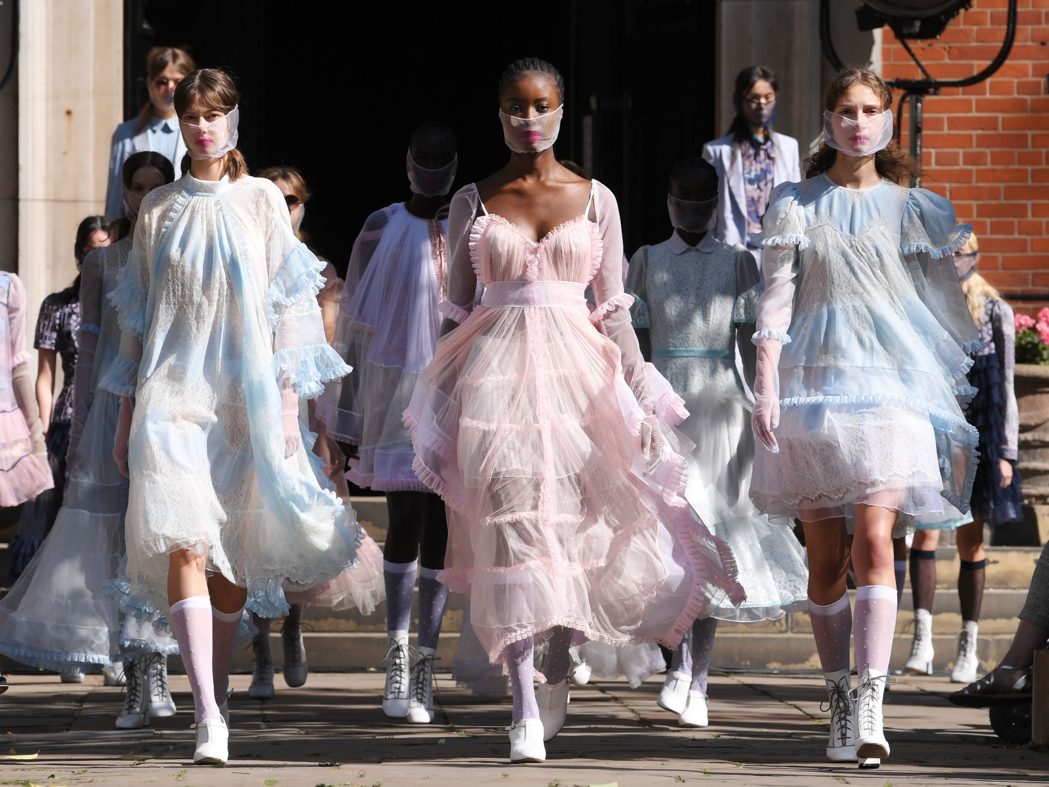 Organza face masks, rave neons and iridescent dresses: Designers embrace escapism as London Fashion Week kicks off