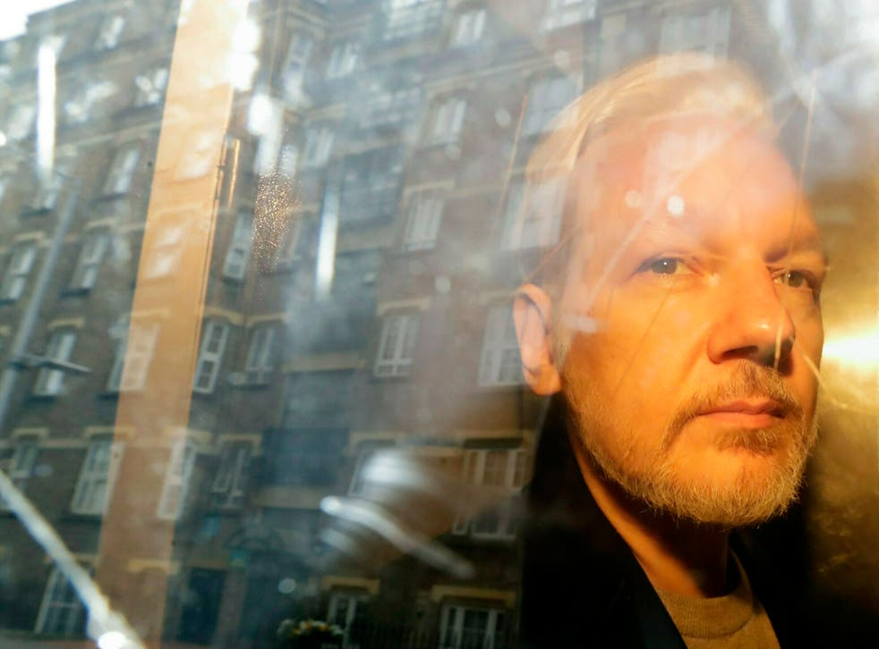 Assange is taken from court, where he appeared on charges of jumping British bail seven years ago, in London in May 2019