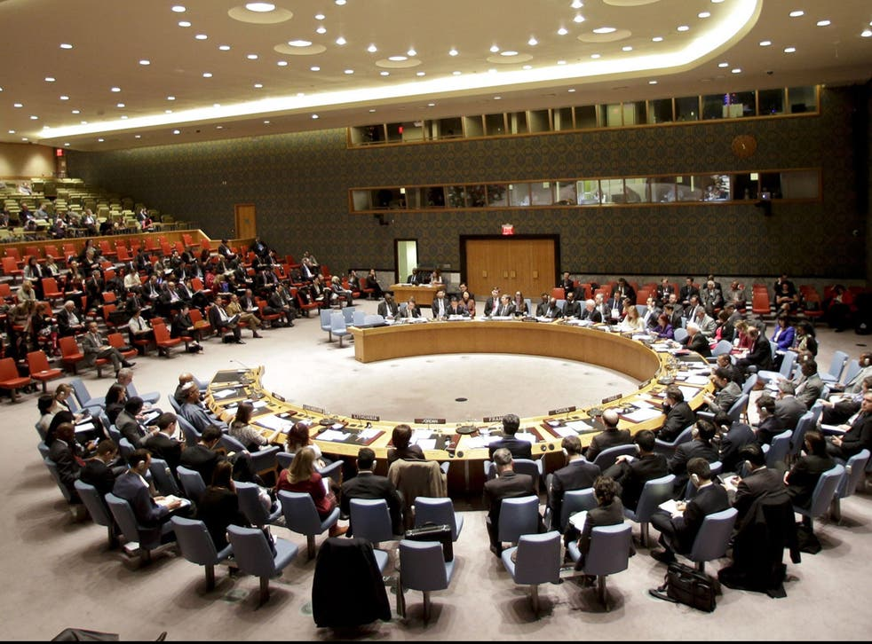The UN Security Council listens to South Korea's United Nations Ambassador Oh Joon during a meeting Monday, Dec 22, 2014