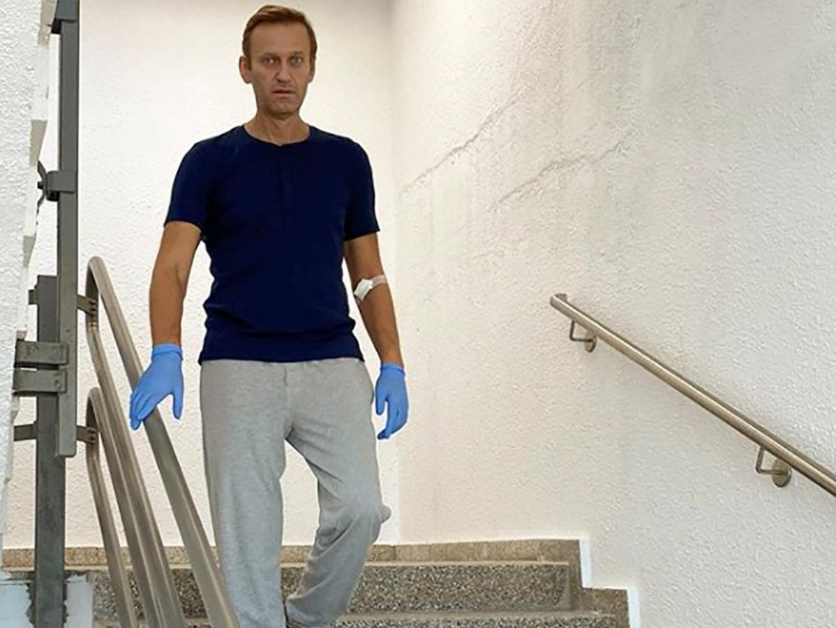 Alexei Navalny pictured walking down stairs during recovery from novichok poisoning - independent