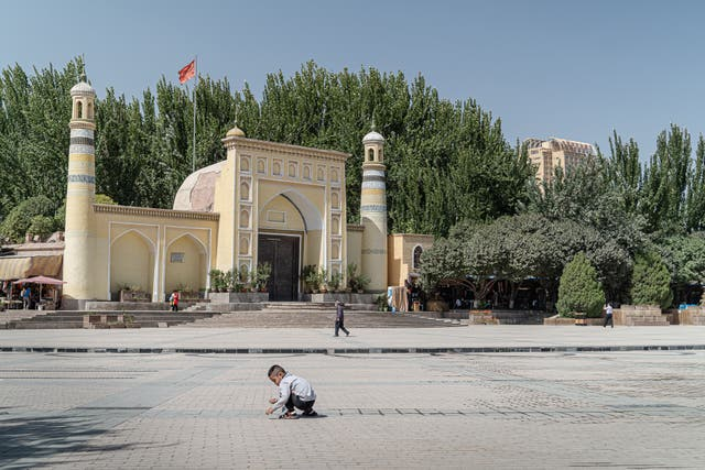 The Chinese flag hoisted above the famous Id Kah mosque in Kashgar stands taller than the crescents and minarets