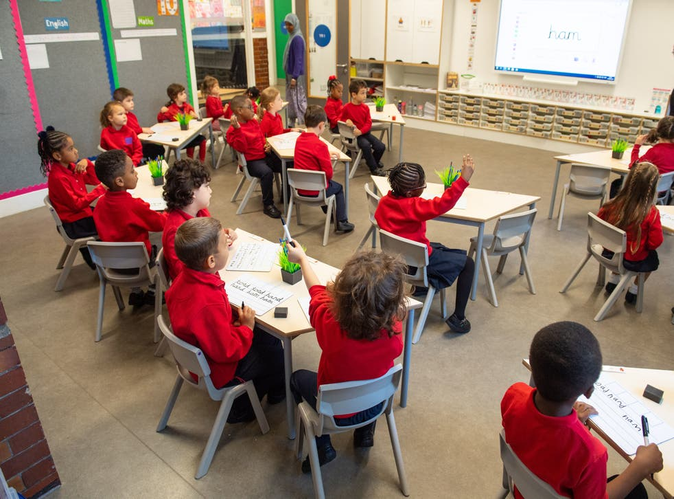 Pupils on the first day back to school at Charles Dickens Primary School in London