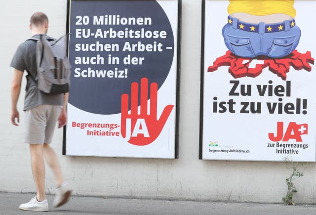 """Swiss People's Party (SVP) electoral posters, including one that translates as """"Too much is too much!"""""""