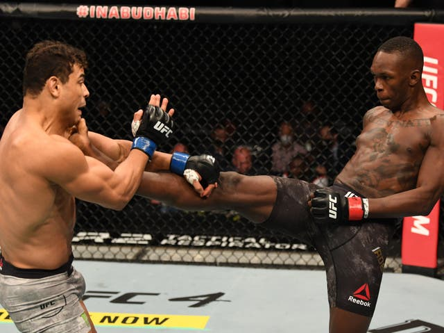 Israel Adesanya (right) put on a masterclass against challenger Paulo Costa