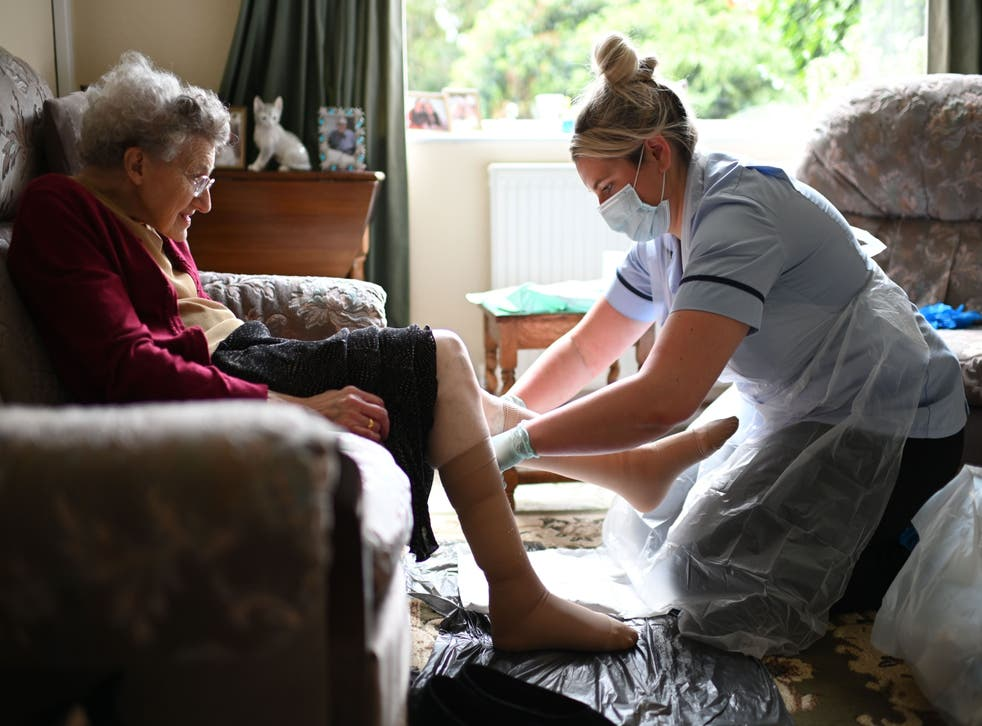 District nurse Rebecca McKenzie changes the dressings on Margaret Ashton's legs to treat ulcers