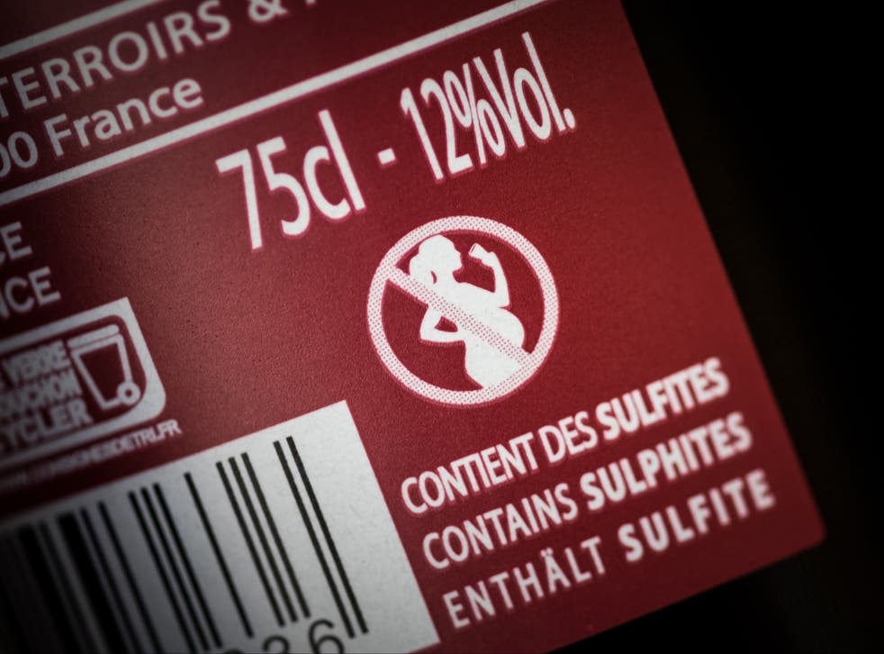 A French wine bottle with an icon picturing a forbidden sign on a pregnant woman drinking