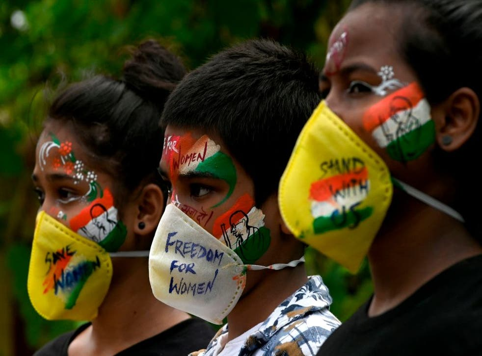 Indian students paint their faces to condemn the gang-rape of a 19-year-old woman in Bool Garhi village