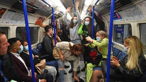 People on a Northern Line train in London, after the 10pm curfew pubs and restaurants are subject to in order to combat the rise in coronavirus cases in England