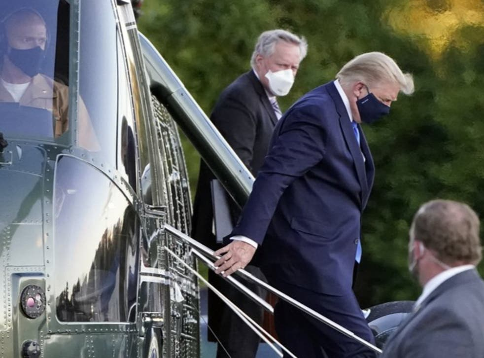 Donald Trump, seen here arriving at Walter Reed military hospital on Friday, says he will return to the White House on Monday evening.