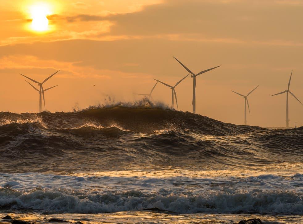 Wind turbines at sunrise off the northeast coast of England