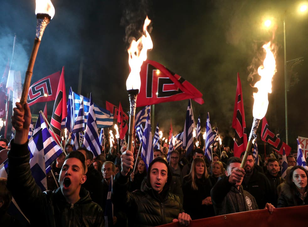 Supporters of far-right Golden Dawn take to the streets with torches