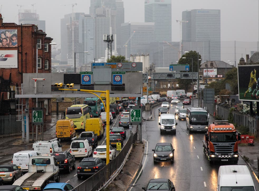 <p>Rush-hour traffic in London: the PM has pledged to cut the UK's emissions by at least 68 per cent by 2030</p>