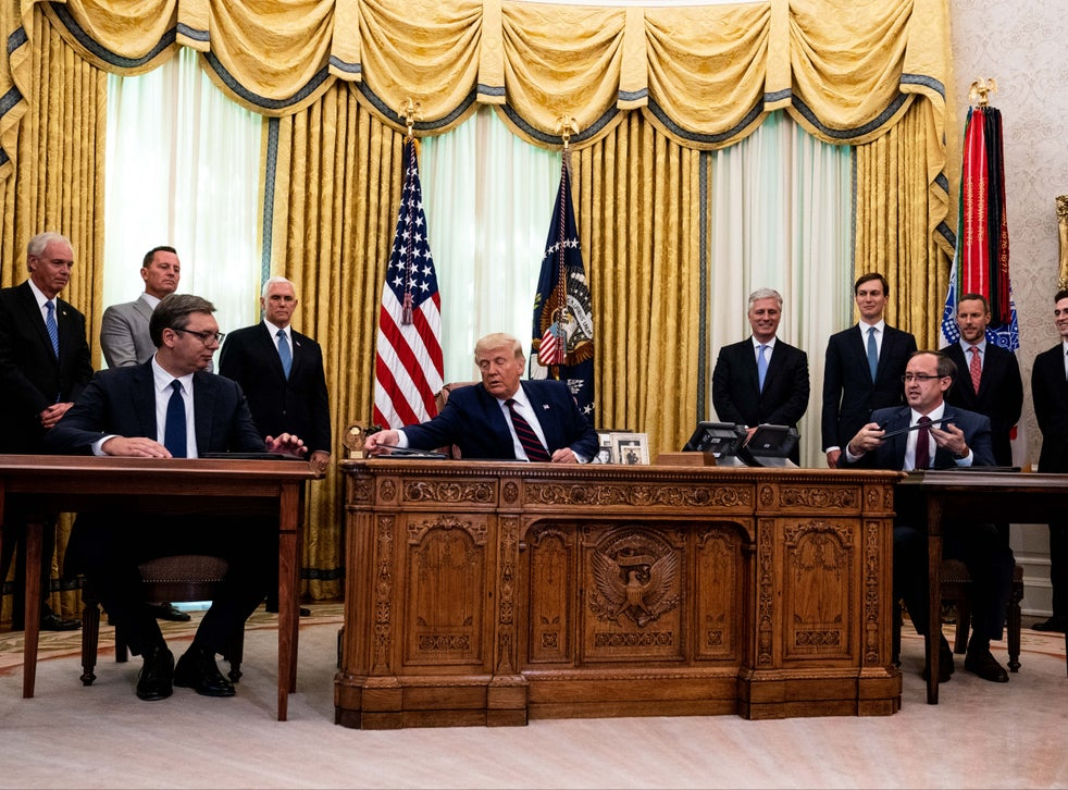 Donald Trump (centre) participates in a signing ceremony and meeting with Serbian president Aleksandar Vucic (left) and Kosovo prime minister Avdullah Hoti (right)