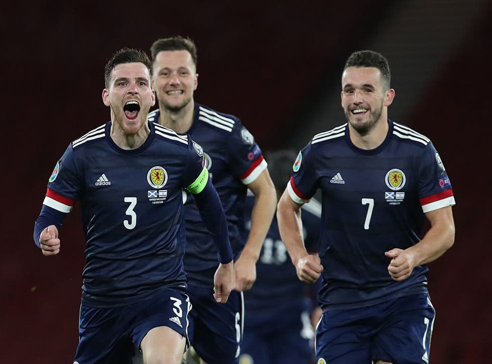 Scotland celebrate after winning the shoot-out