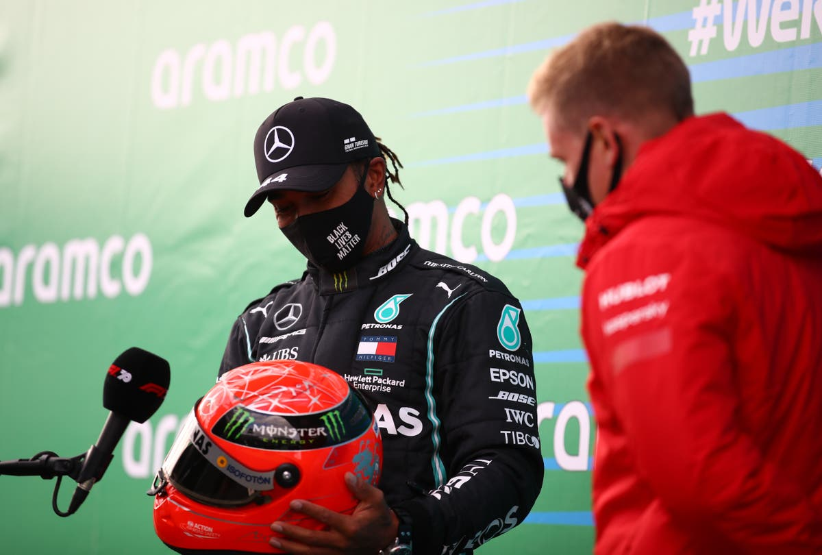 Lewis Hamilton given Michael Schumacher's helmet by his son after historic win