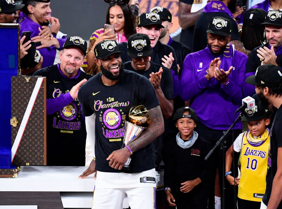 Lebron James celebrates with the MVP trophy