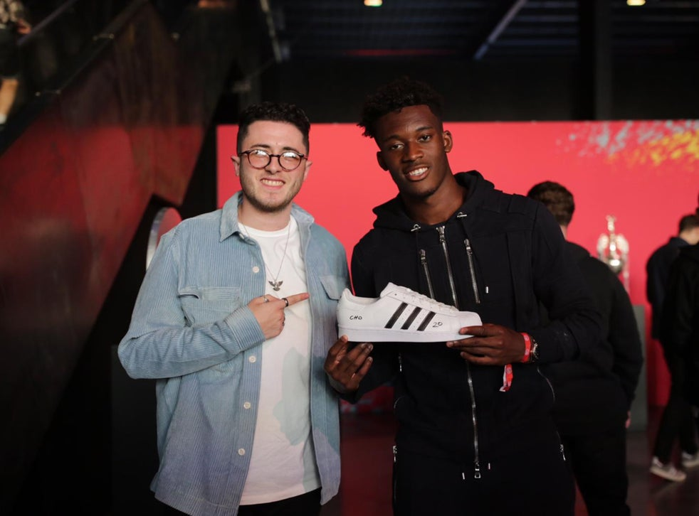 Jordan Dawson presents Callum Hudson-Odoi with a custom Adidas shoe