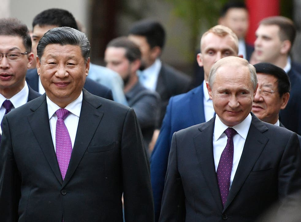 Russian President Vladimir Putin and Chinese President Xi Jinping visit the Moscow Zoo, which received a pair of giant pandas from China, in Moscow, Russia