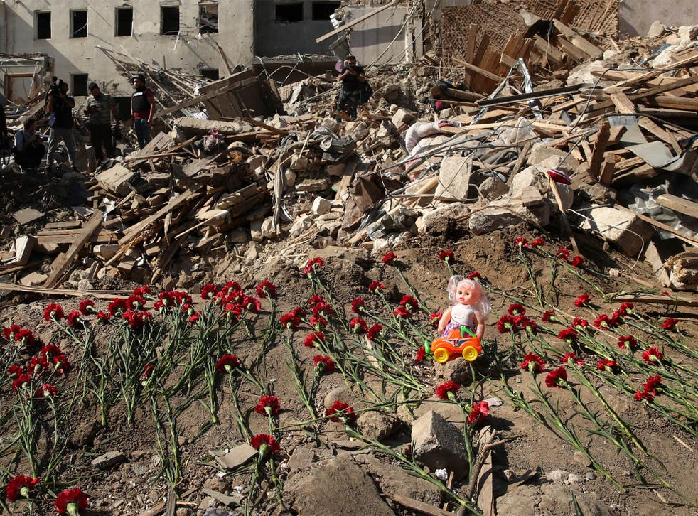 Commemorating people died in a rocket attack on a residential area of the city on 11 October