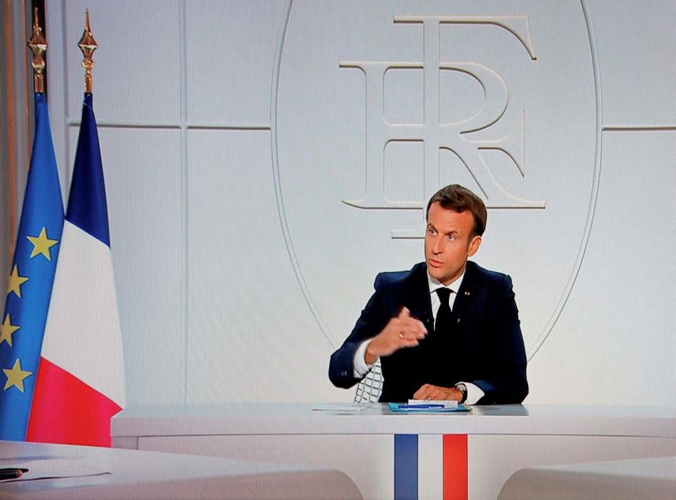 French President Emmanuel Macron addresses the nation during a televised interview from the Elysee Palace concerning the coronavirus situation in France, in Paris on 14 October, 2020