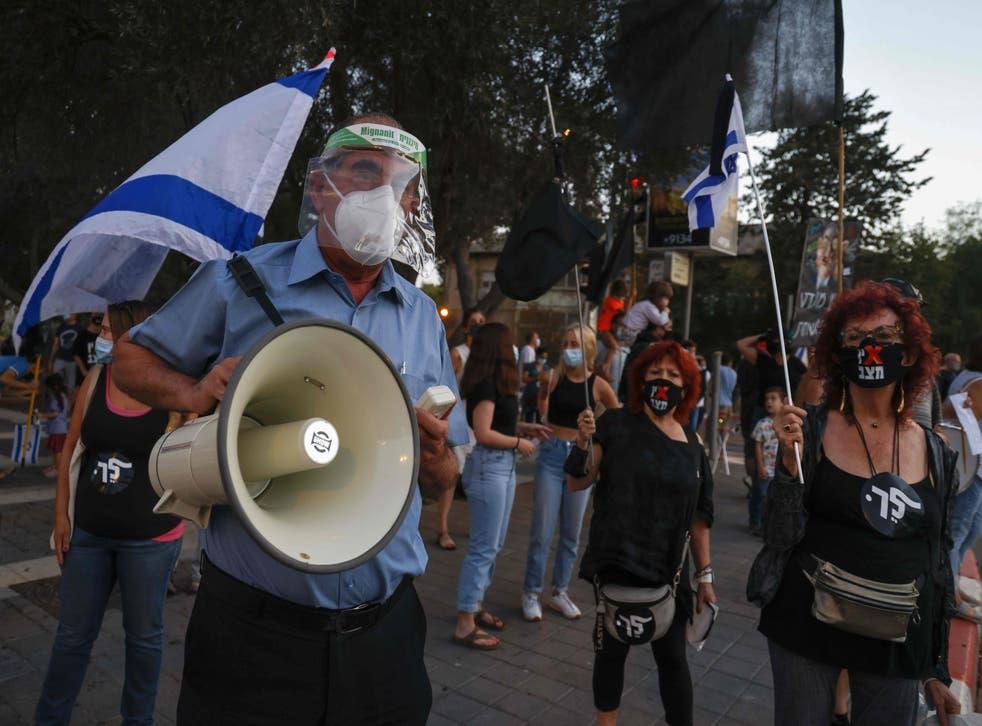 Israeli protesters gather for a demonstration against Prime Minister Benjamin Netanyahu's government in Jerusalem