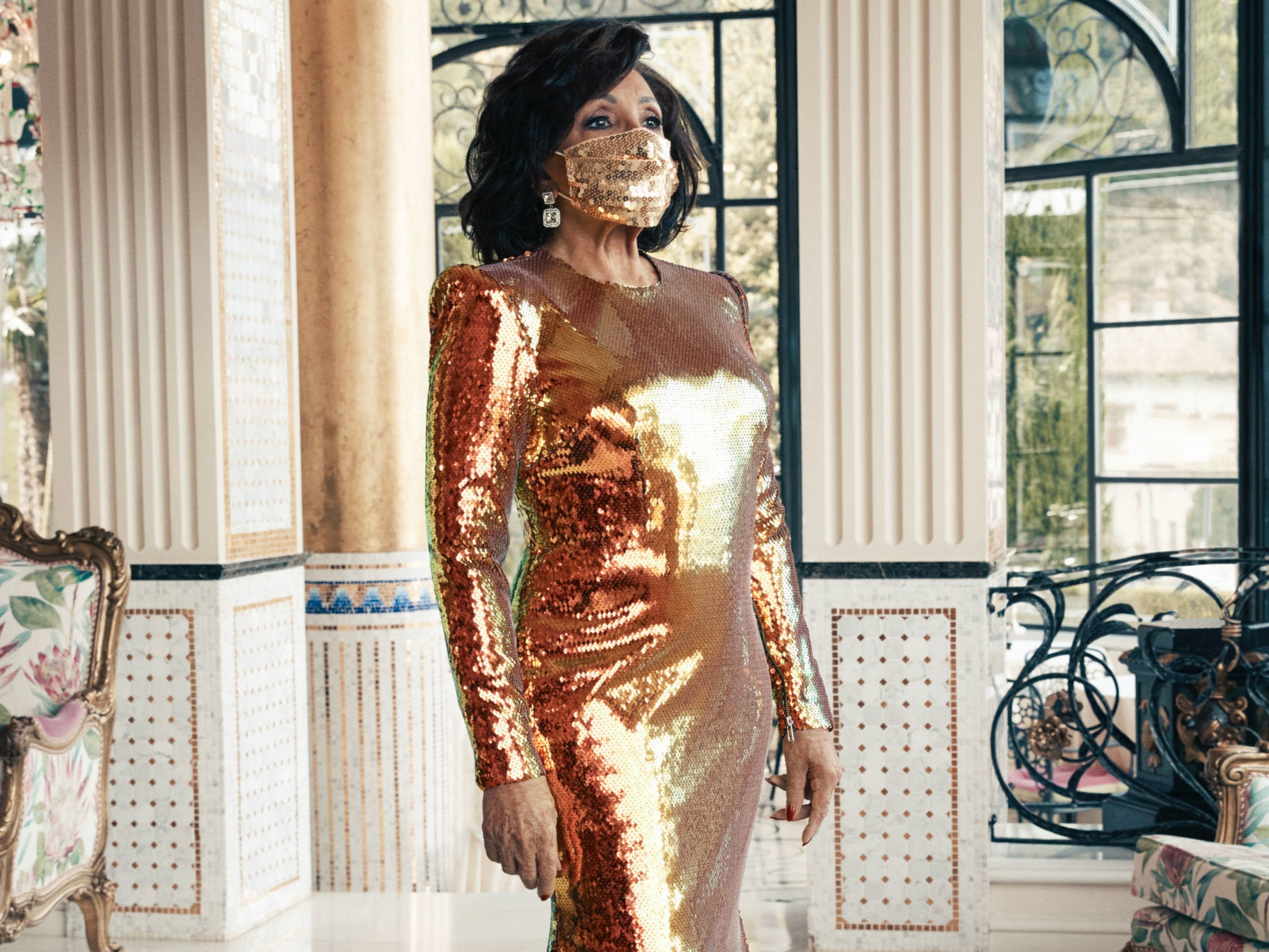 Shirley Bassey wears gold sequin gown and matching face ...