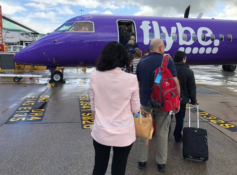Airborne again? Passengers boarding a Flybe aircraft at Manchester airport before the airline collapsed in March 2020