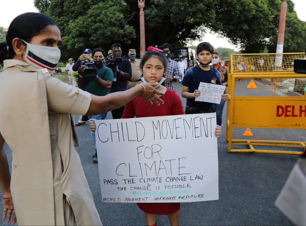 Climate activist Licypriya Kangujam, aged nine, carrying a placard on September 23, 2020. She was detained by police in India at the weekend, according to reports
